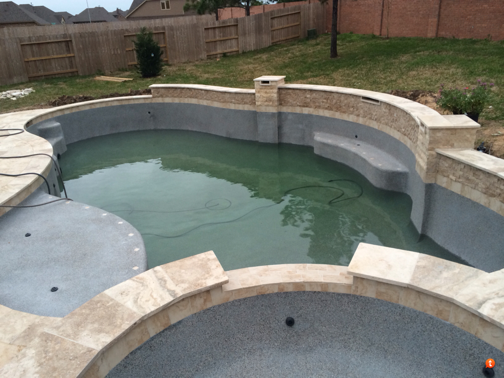 Antique travertine pool coping and paving tiles