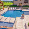 Ivory travertine outdoor pool tiles and pool coping