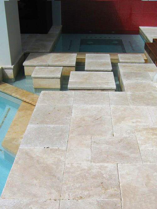 Ivory travertine pool tiles and coping tumbled edges