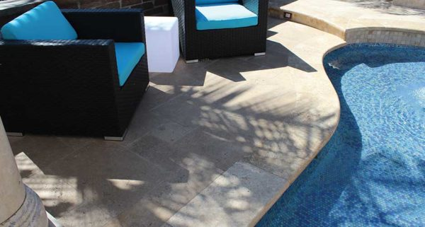 Ivory travertine tumbled edge pool coping