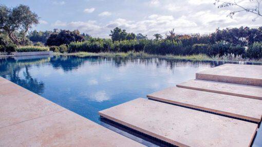 Ivory travertine tumbled pool coping pavers