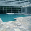 Outdoor pool tiles and coping in silver travertine french pattern