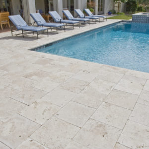 Travertine Pavers around a swimming pool in Melbourne