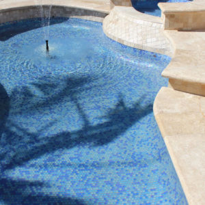 travertine pool coping and pavers in Ivory