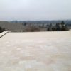 unfilled and tumbled ivory travertine