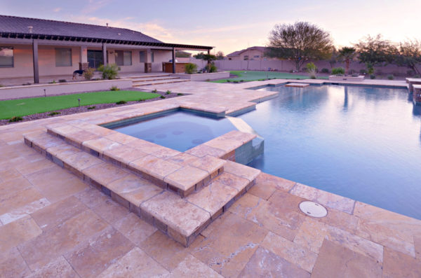 Noce travertine outdoor tiles and pool coping
